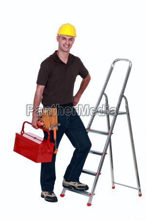 craftsman climbing a ladder