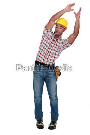 craftsman carrying something and trying to