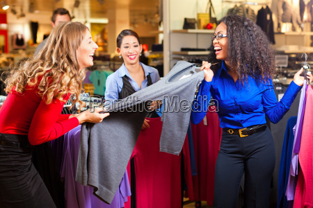 women in a shopping mall while