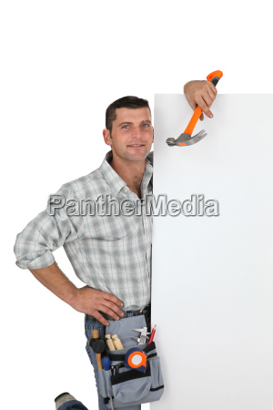 handyman holding a hammer and a