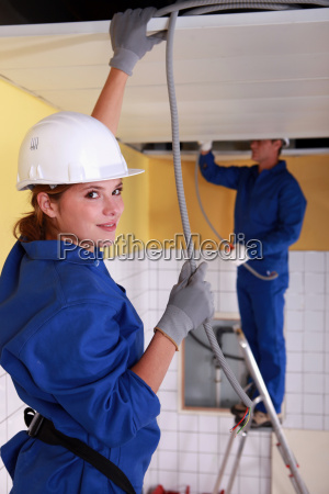 female plumber apprentice and tutor at