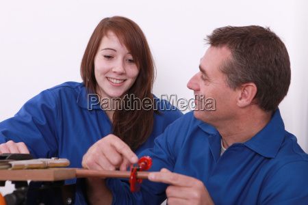 young female apprentice and instructor