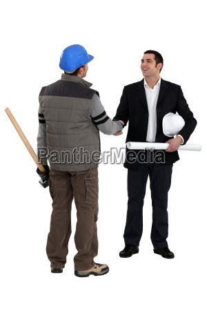 architect shaking laborer039s hand