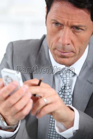 male executive using cellphone