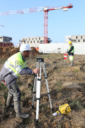 civil engineers on site with surveying