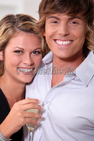 young couple with toothy smile and