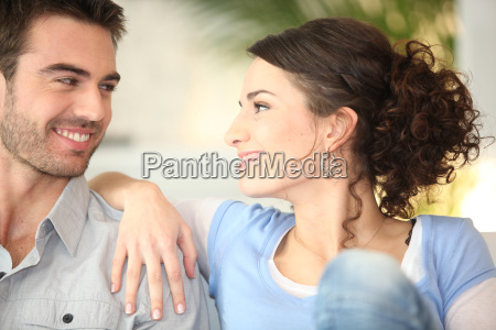 affectionate young couple on couch