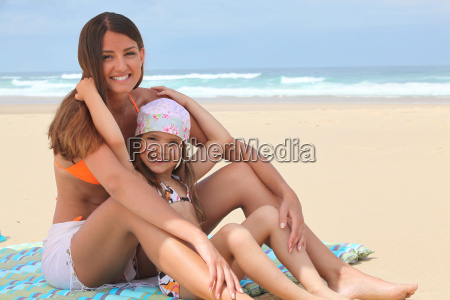 mother and daughter sitting on a