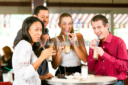 friends drinking latte and eat cake