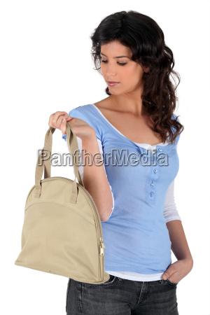 young woman carrying handbag