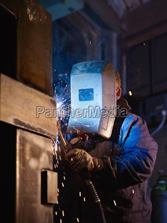 man at work as welder in