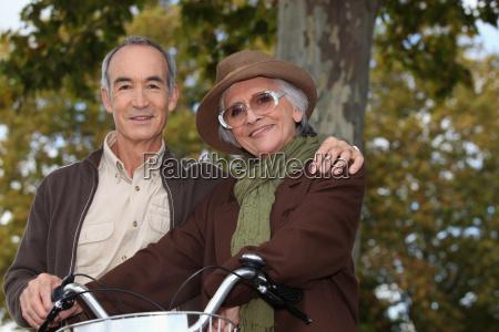 elderly couple on a bike ride