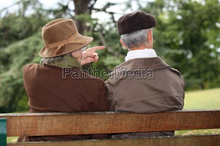 senior couple seated on a park