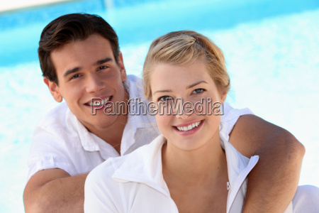 grinning young couple