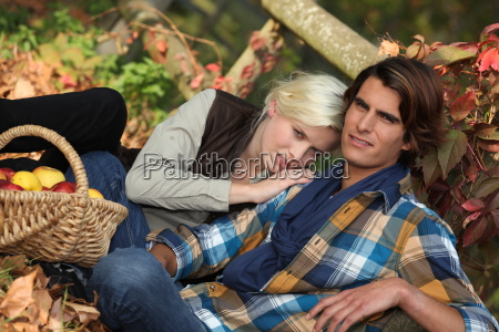 couple sitting in dead leaves