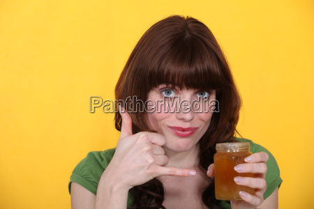 woman with a pot of honey