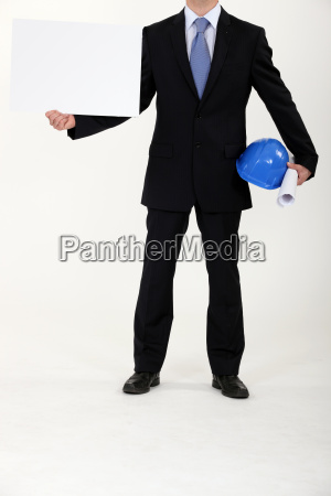 architect holding blank poster