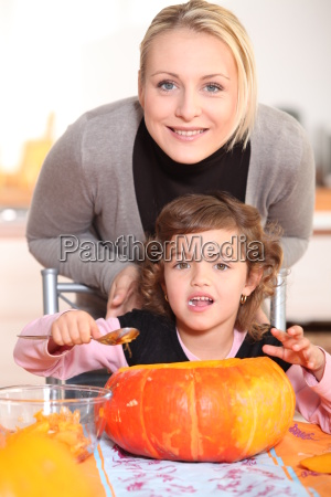 mother and daughter carving jack o