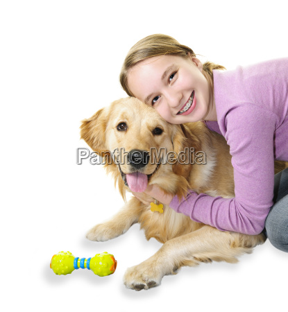 girl hugging golden retriever dog