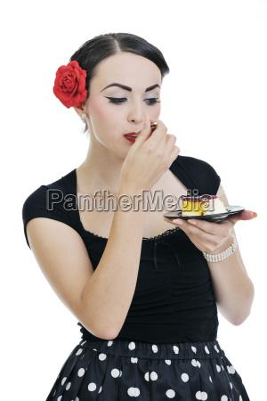 beautiful young woman eat sweet cake