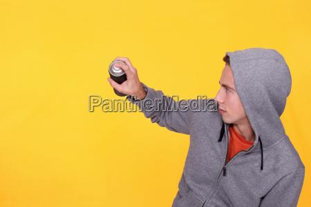 teenager wearing hoodie against yellow background