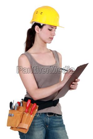 female builder holding clipboard