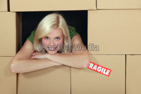 woman surrounded by a wall of