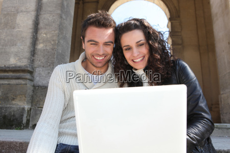 couple sitting with a laptop
