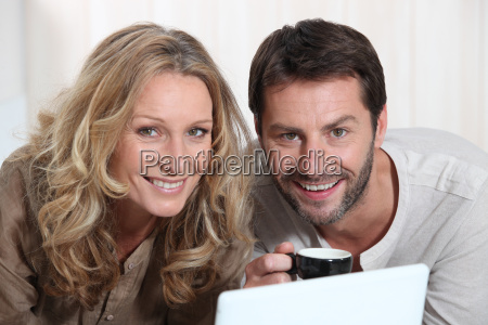 couple smiling on laptop