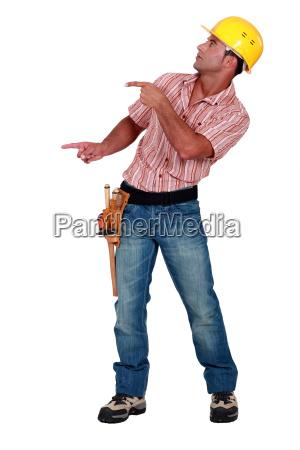 workman pointing something on white background