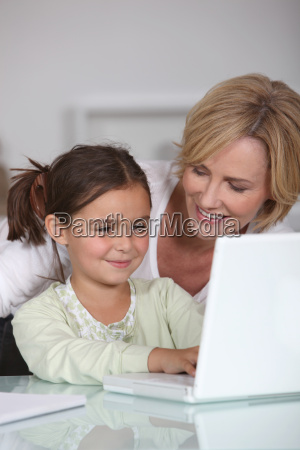 mother and young daughter using a