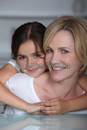 mother and daughter sat by glass