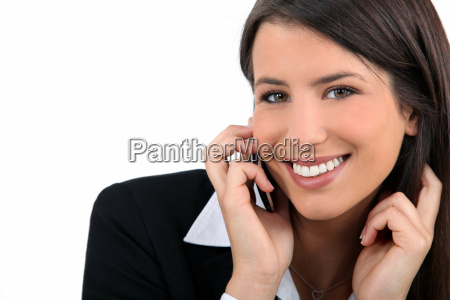 smiling woman using a mobile phone
