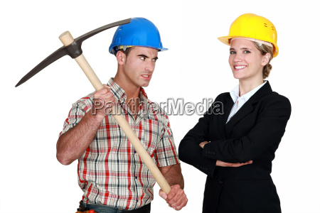 builder aiming his pickaxe at a
