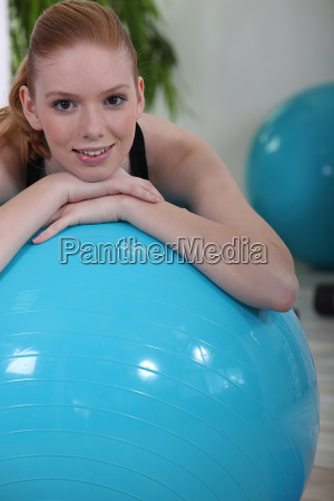 woman using an exercise ball in