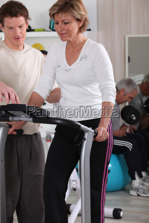 woman with her personal trainer