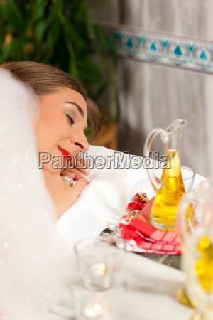 wellness woman receiving massage in