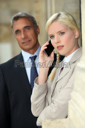 blond woman on phone next to