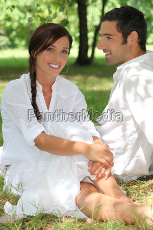 handsome couple in a park