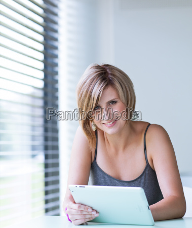 businesswomancollege student using her tablet computer