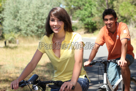 young couple on bike ride