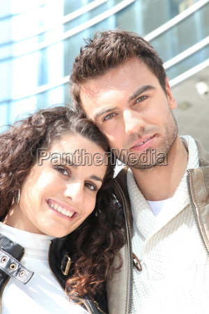 couple stood outside high rise building