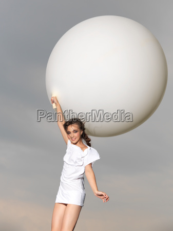 happy woman jumping with big white