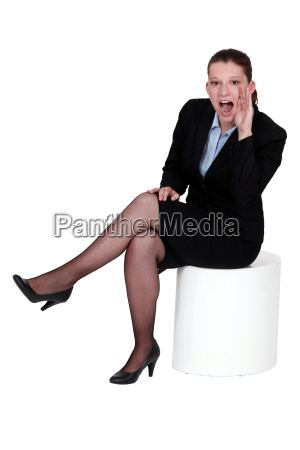 woman in a suit shouting