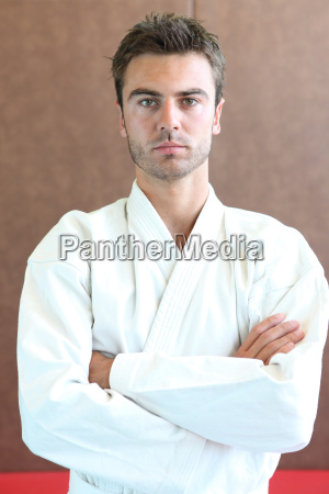judo practitioner standing on a mat