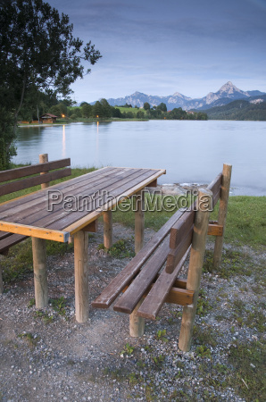 bench and table at the lake