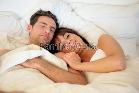 happy couple lying in bed