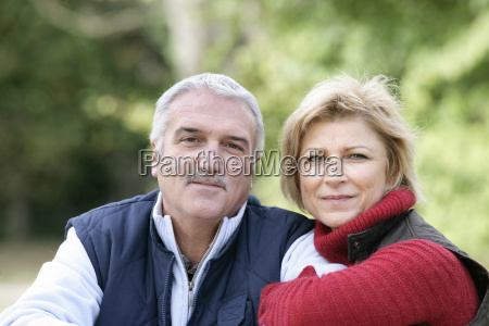 couple sat relaxing in park