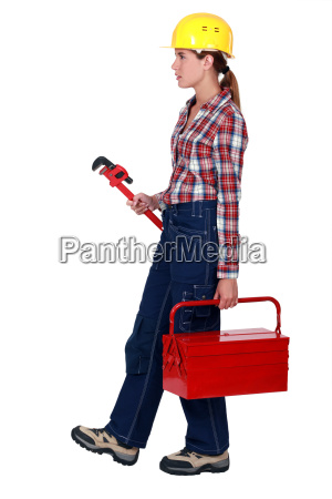 woman with a toolbox and wrench