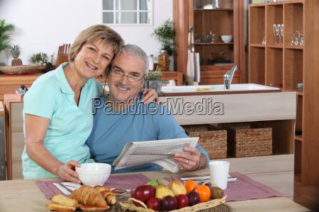 happy senior couple embracing